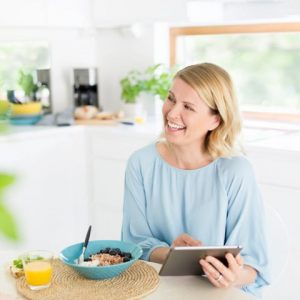 smiling woman cooking tablet connected vpn
