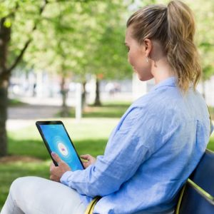 vpn tablet woman outside sun sitting